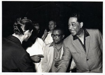 Duke Ellington shakes hands with Goan saxophonist, and bandleader, Rudy Cotton.