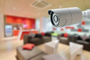 Bullet style CCTV security camera overlooking living room
