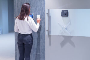 Woman using access control with a bank safe