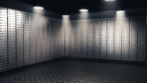 Spotlight on multiple stacked safe deposit boxes