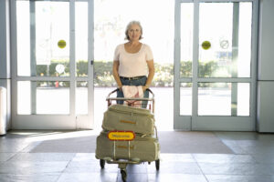 Automatic slide door woman walking with luggage