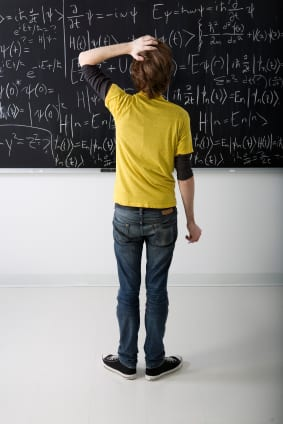 A student tries to solve a math problem.