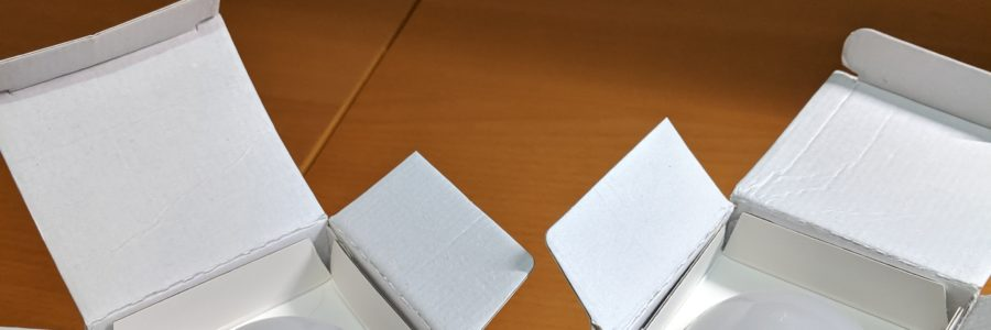 A pair of Gosund Smart Wifi LED Bulb Box Opened and arranged on table