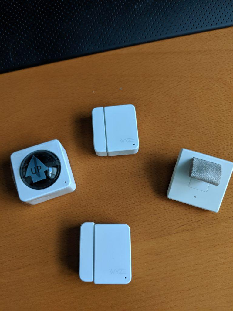 Wyze Sensor Starter Kit arranged on table.