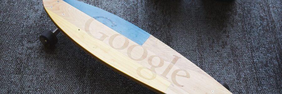 Stock Photo of Google Skateboard Longboard Under Desk