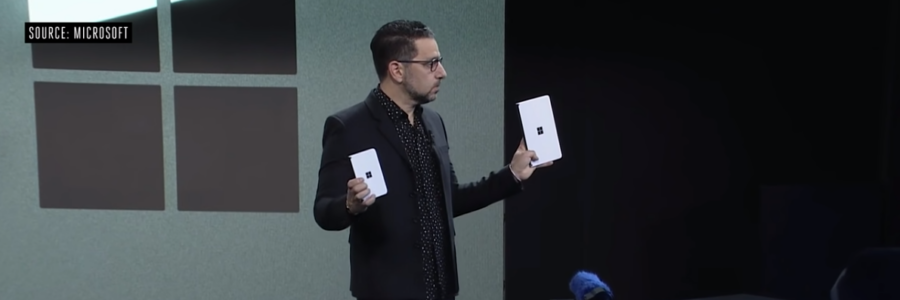 picture from Microsoft Surface 2019 event; Person holding up the new Surface Duo phone and the Surface Neo tablet