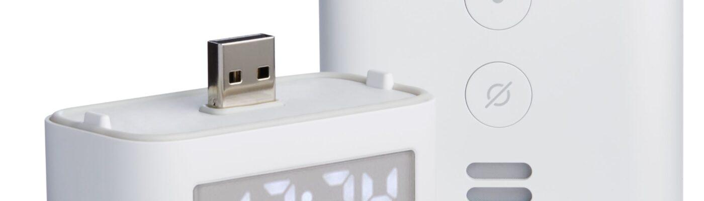 Picture of the Echo Flex Smart Clock Accessory beside Echo Flex