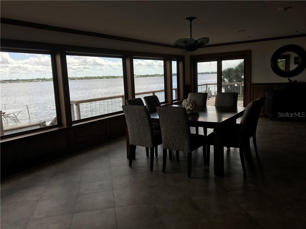 Spacious great rDining area with large windows for beautiful views of Lemon Bay.oom loaded with versatility to be set up in whatever manner suits your lifestyle.
