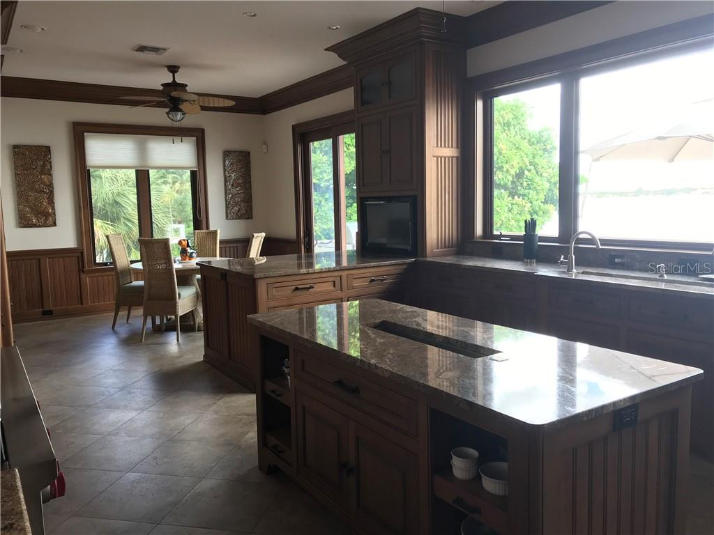 A chef's dream! Solid cherry kitchen loaded with features to assist in preparing the grandest meal. Cozy dining area off kitchen again with strategically placed windows for beautiful views.