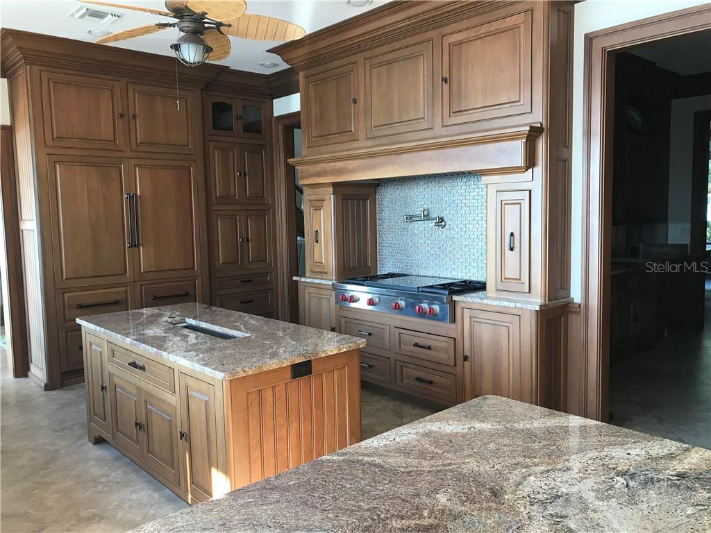 Beautiful granite countertops compliment the solid cherry wood cabinetry.