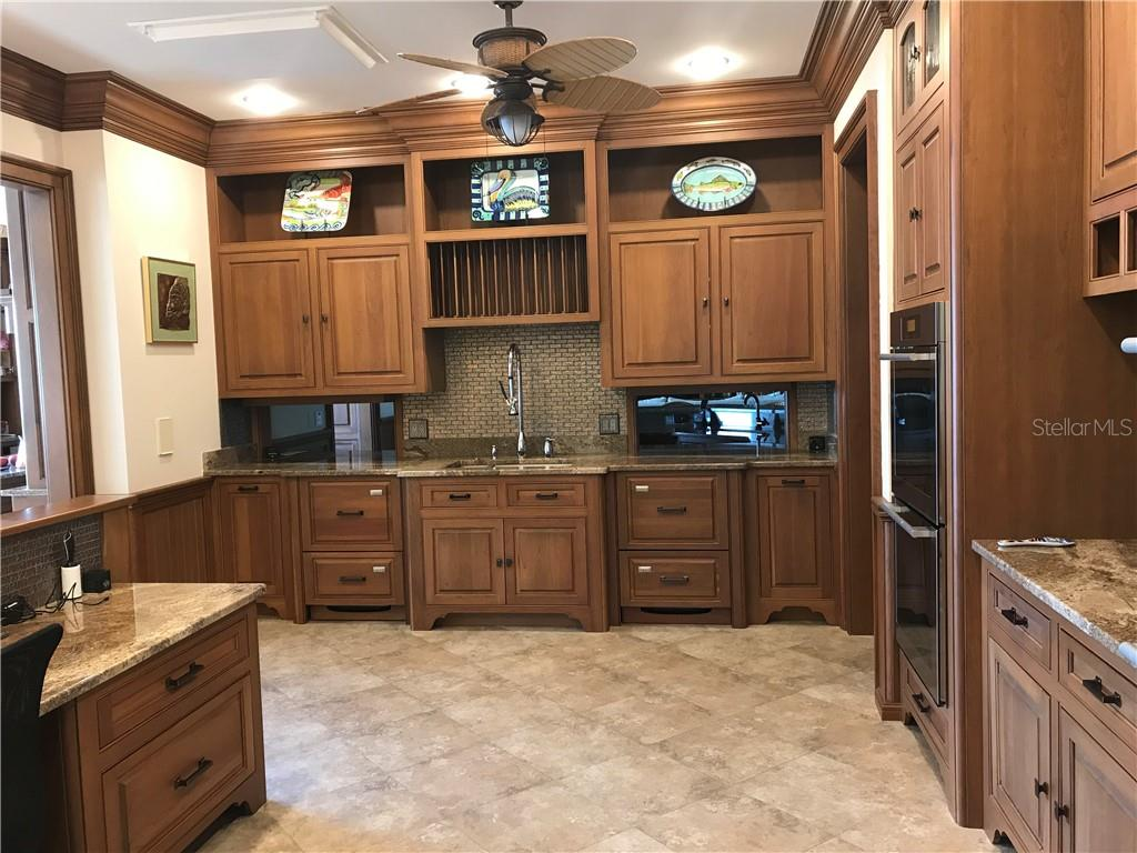 Butler's kitchen w/pass through to Billiard Room. Beautiful solid cherry, double ovens, 4 dishwasher drawers, lots of work room and storage.