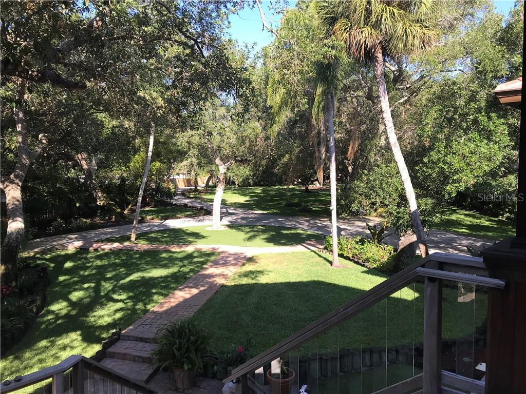 Beautiful mature wooded grounds greet you as you drive into this property. The circular drive give you ease of access in and out of the property.