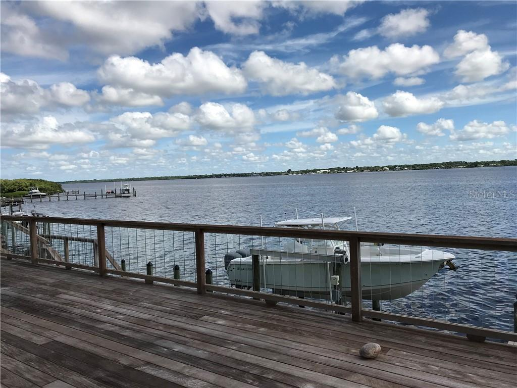 150 feet of seawall with spacious desk overlooking the dock, lift and Lemon Bay.