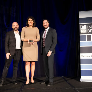 Charlie Giancarlo, CEO of Pure Storage, Katie Ferrick, Sr. Director of Workplace, Community & Environment of LinkedIn, and Kevin Zwick, CEO of Housing Trust Silicon Valley, presenting Katie with the 2019 Housing Champion Award