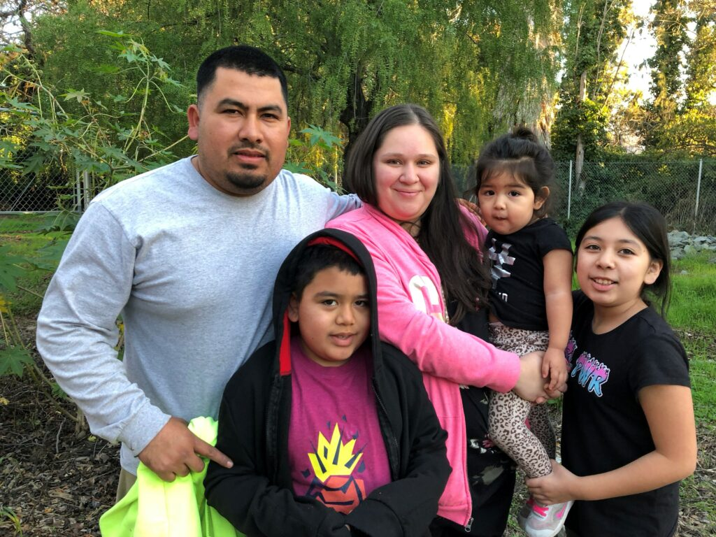 Griselda and family in the community garden at Betty Ann Gardens