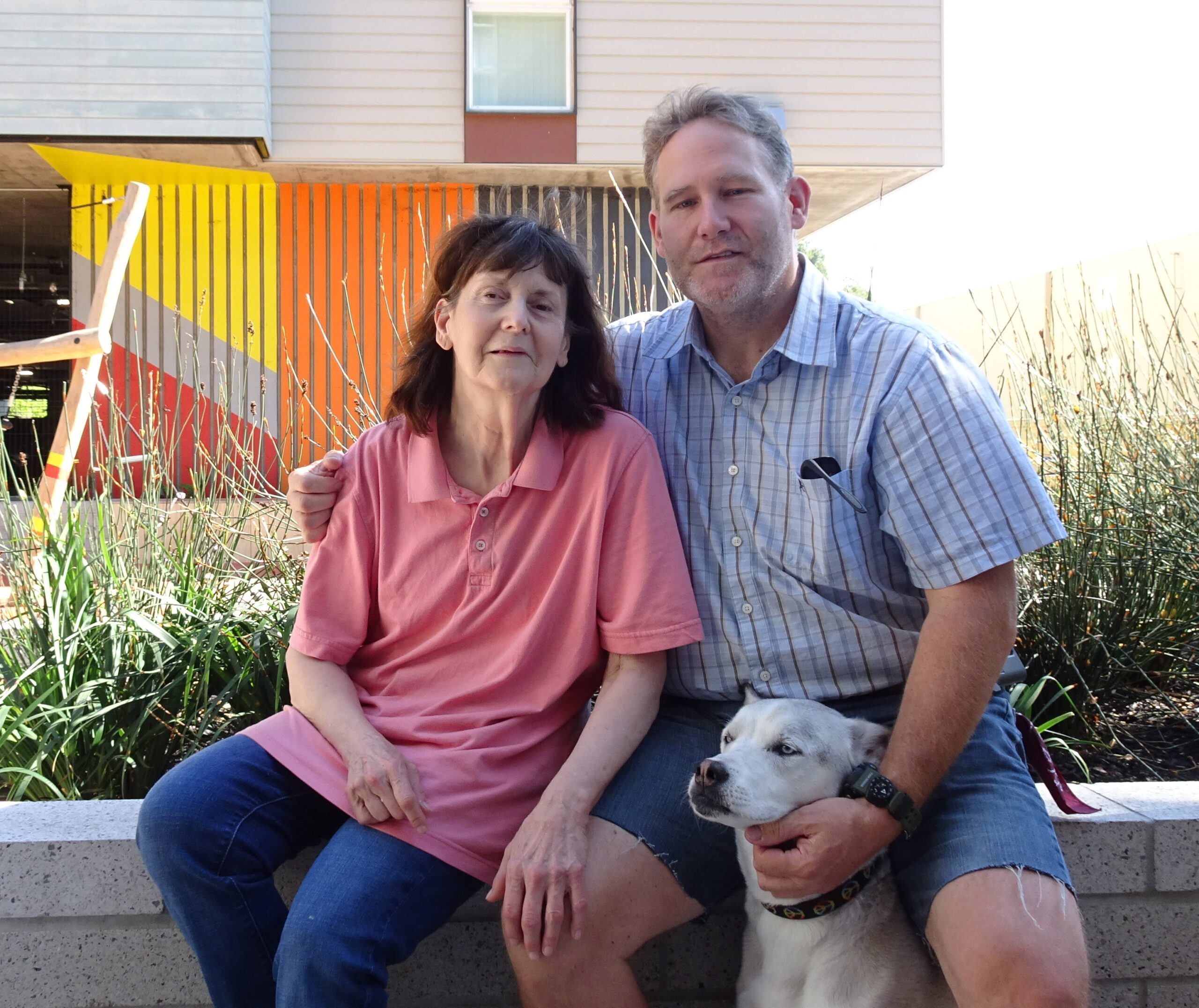 Phillip and Marjorie - with their dog Sasha - at home at Edwina Benner Plaza in Sunnyvale