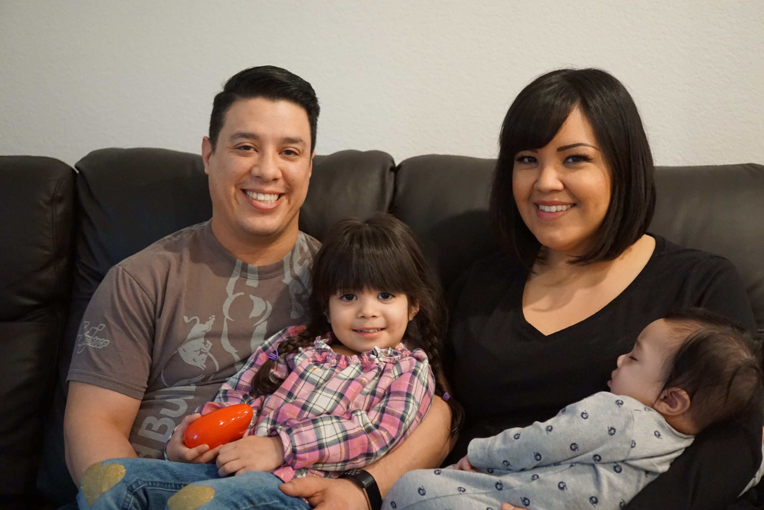 Jose with his wife Marcella and their children at home in Santa Clara