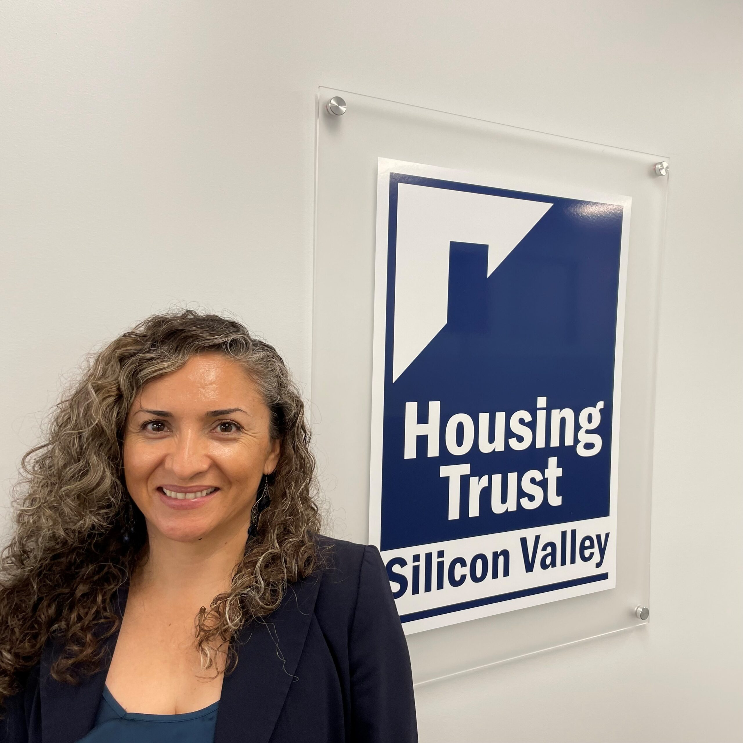 Lupita with Housing Trust Sign