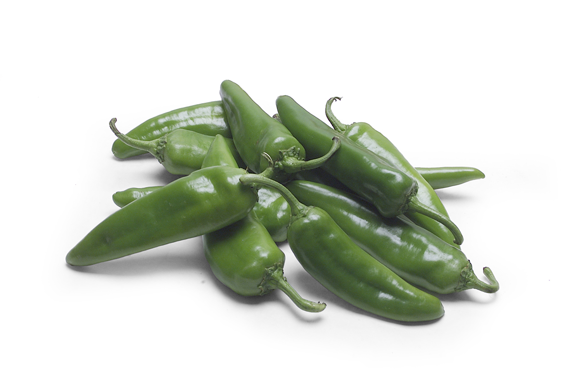 Know Your Chile Peppers: The Ultimate Guide l anaheim chile peppers on white