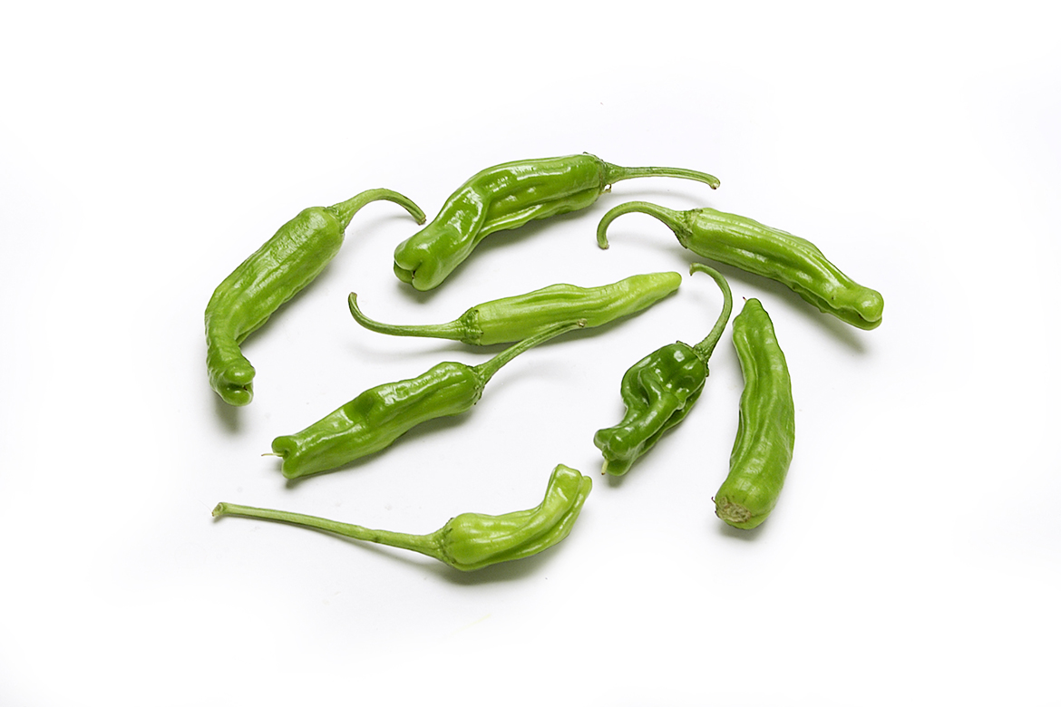 Know Your Chile Peppers: The Ultimate Guide l shishito peppers on white