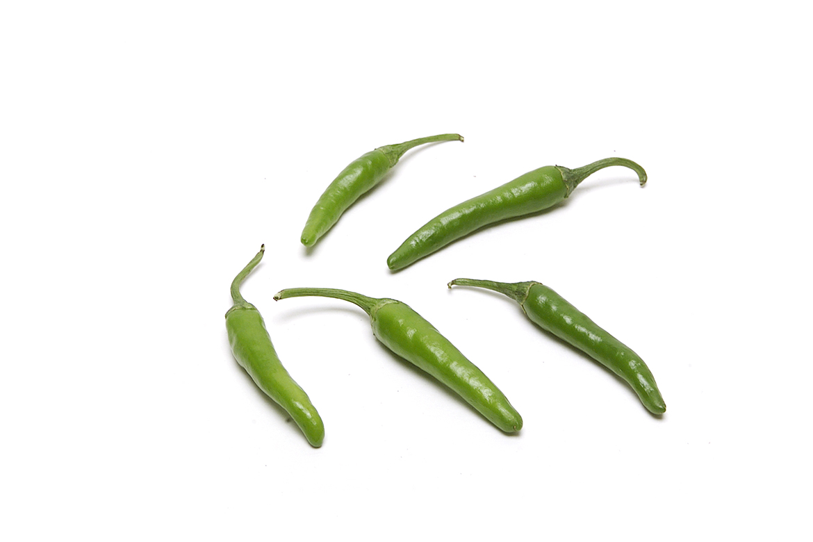 Know Your Chile Peppers: The Ultimate Guide l thai chile peppers on white