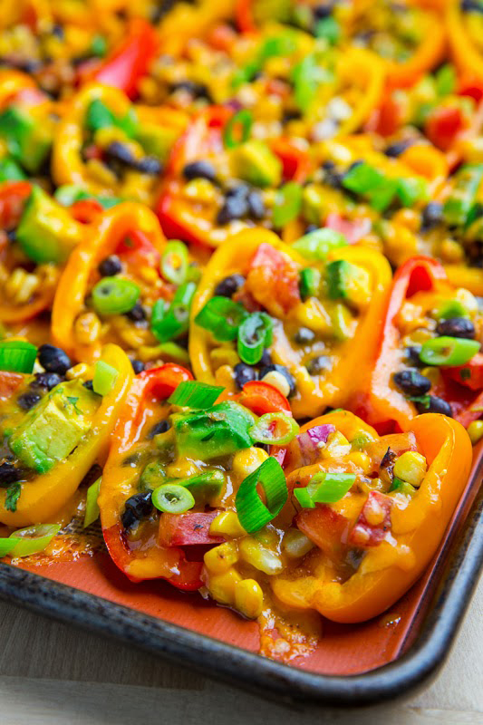 25 delicious ways to heat up National Pepper Month l mini pepper nachos with corn, black beans and avocado