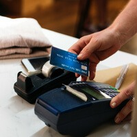 A customer uses their credit card to buy something.