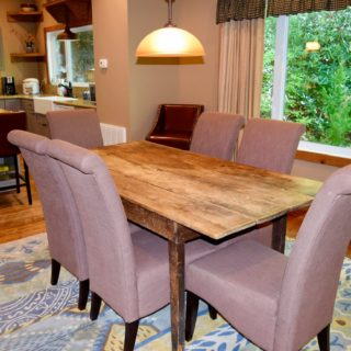 The Huntley features an Antique Kitchen Table - The Cove at Fairview Vacation Rentals - Asheville NC