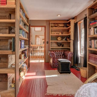 Western Bedroom features a small library - The Cove at Fairview Vacation Rentals - Asheville NC