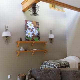 Single bed in Prayer Ridge living room - The Cove at Fairview vacation rental - Asheville, North Carolina