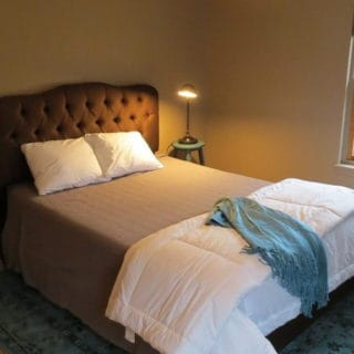 Queen bed in downstairs bedroom - The Cove at Fairview vacation rental - Asheville, North Carolina