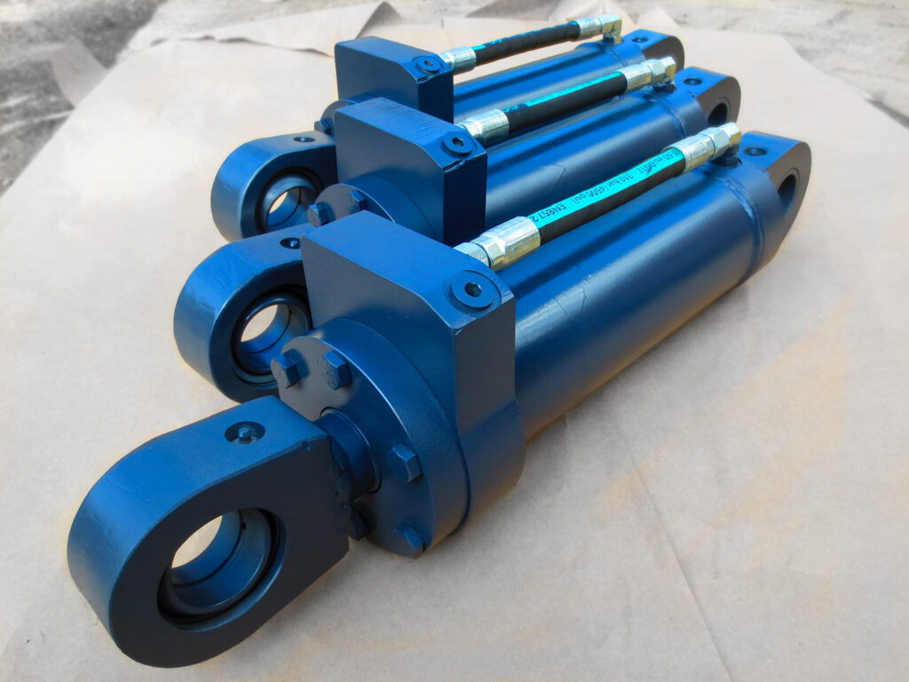 Heavy duty hydraulic cylinders for heavy equipment, such as excavators, wheel loaders