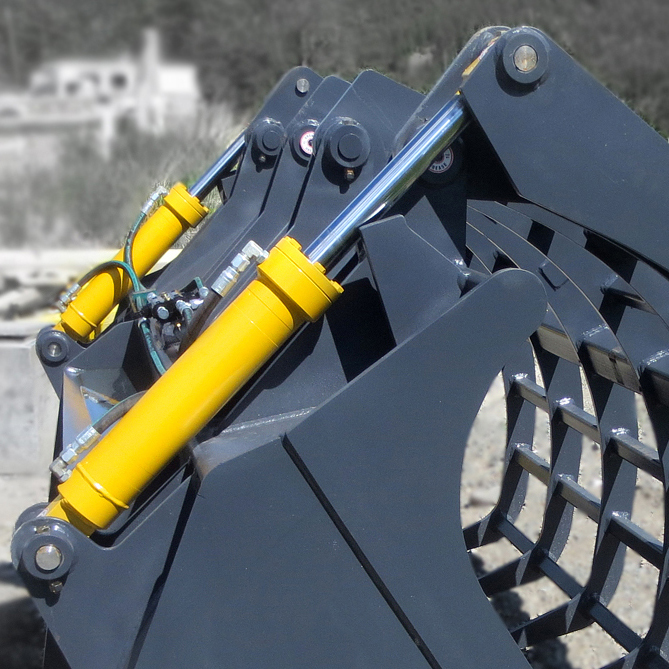 Dual hydraulic cylinders manufactured by Red Raven Hydraulics, installed onto a wheel loader corral bucket