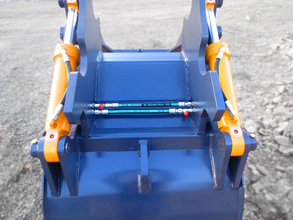 Dual hydraulic cylinders installed on an excavator grapple arm bucket.  Heavy duty hydraulic excavator cylinders