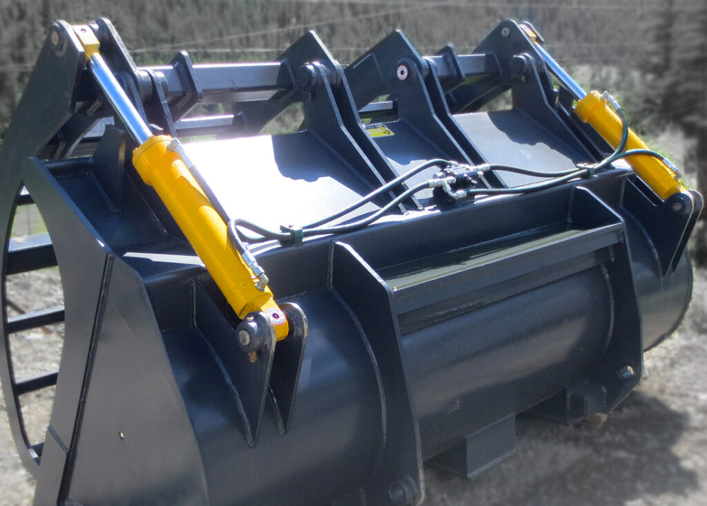 Dual heavy duty hydraulic cylinders manufactured by Red Raven Hydraulics.  Installed onto a wheel loader corral bucket used for agriculture and farming