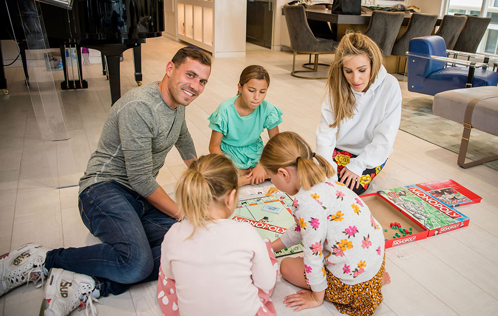 eda and her husband david playing with their children