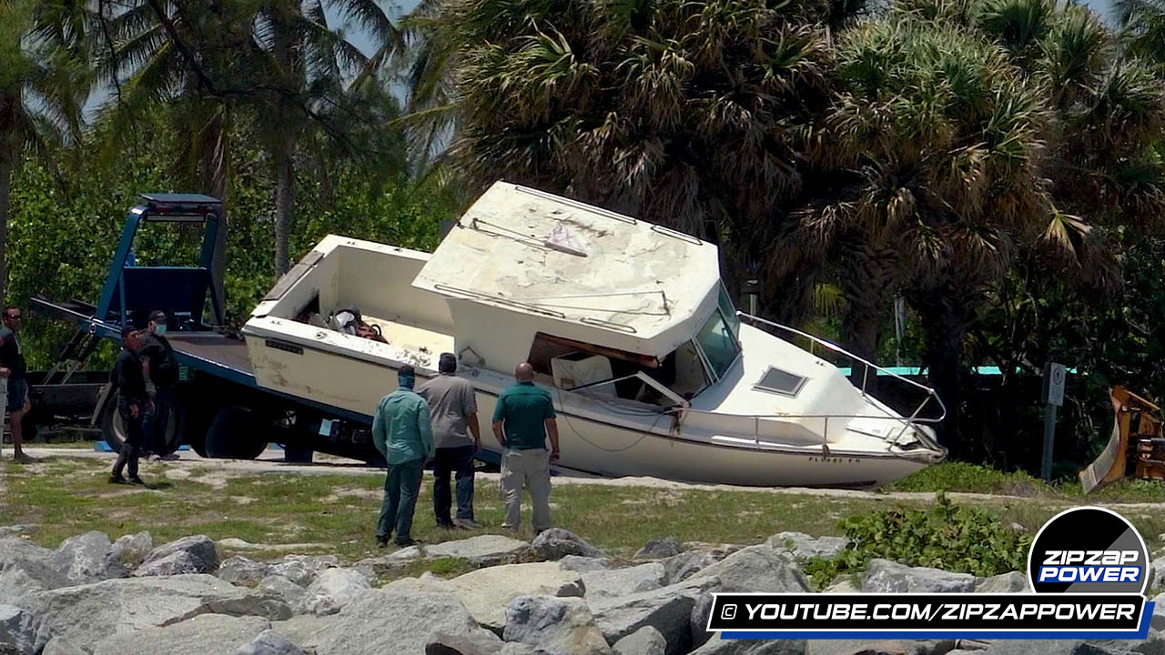 Destroyed Boat on Tow Truck at Haulover Inlet