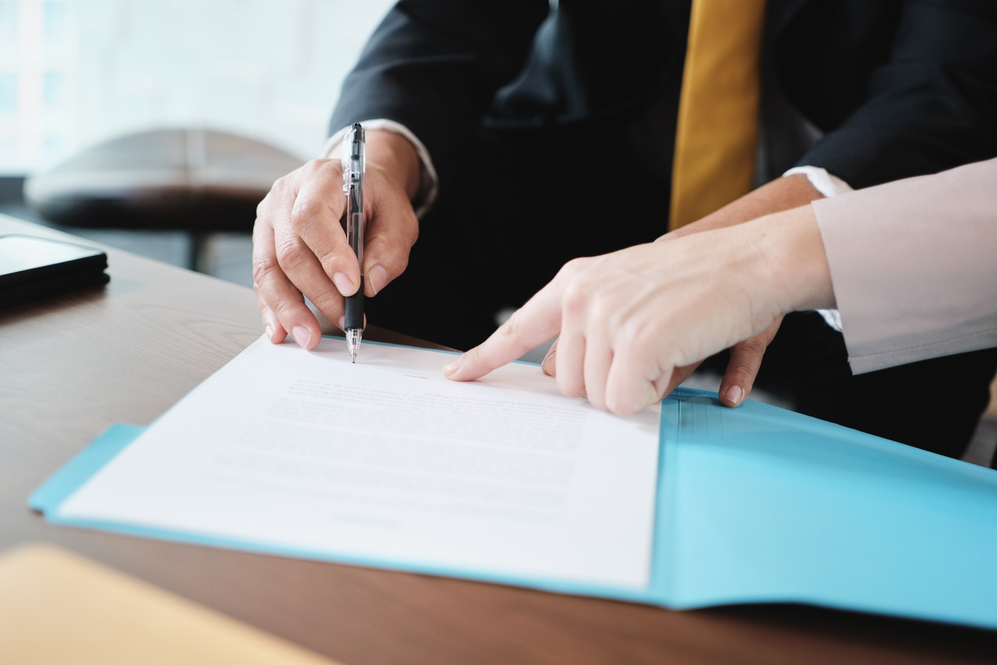 Asian Manager Signing Agreement For Health Insurance With Business Woman