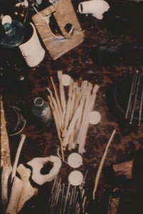 Ivory handled toothbrushes with hog bristles, a bottle, slate pencils, animal bones, part of a smoking pipe, and other artifacts.