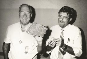 Archaeologist Duncan Mathewson (right) poses with Mel Fisher who holds treasure from Atocha. Mathewson surveyed the Juno Beach wreck site.