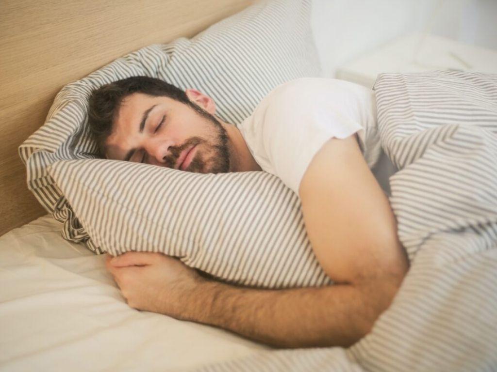 Man sleeping in cozy bed
