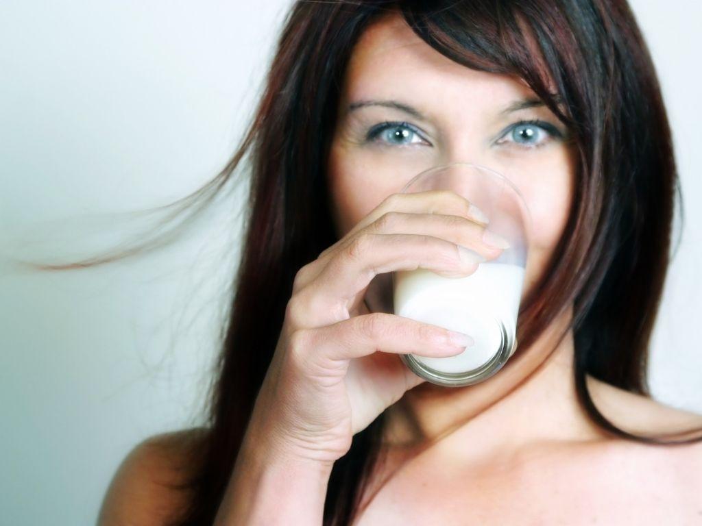 beautiful woman drinking milk