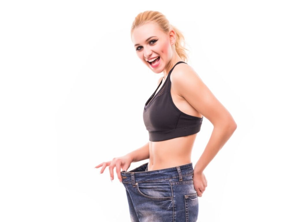 Blonde Women pulling her pants out at waistline