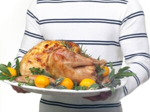 Garnished citrus glazed turkey on a platter ready to be served