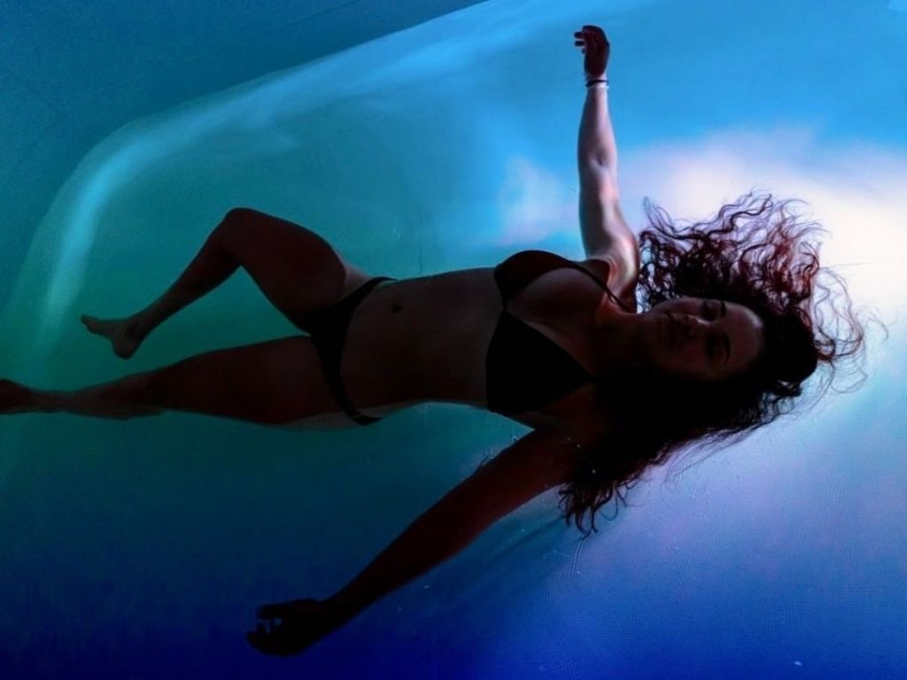 Woman laying in a float tank