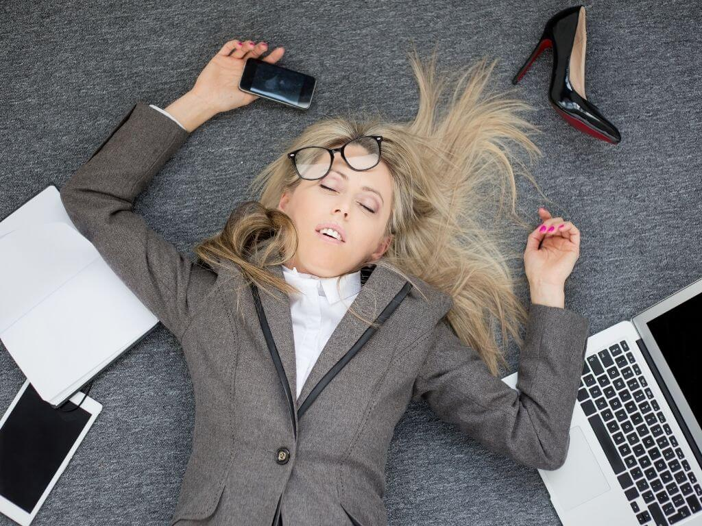 Woman laying on floor in overwhelm