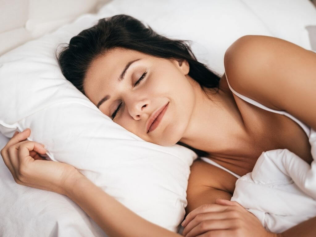 beautiful young woman smiling in her sleep