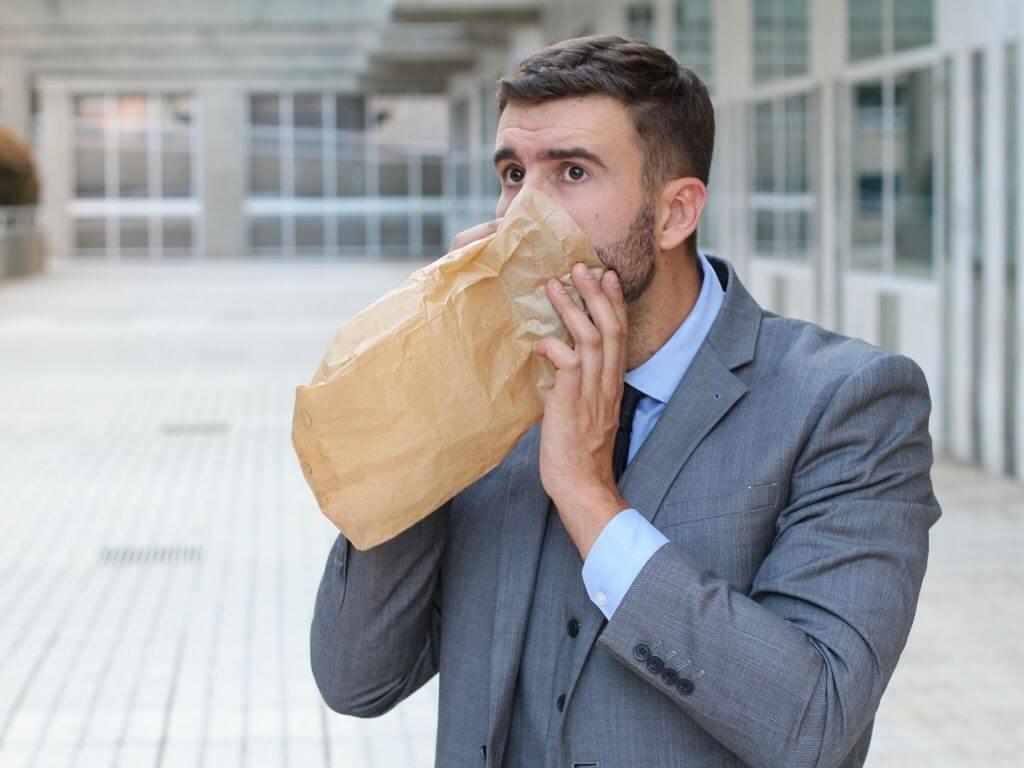 Businessman having a panic attack