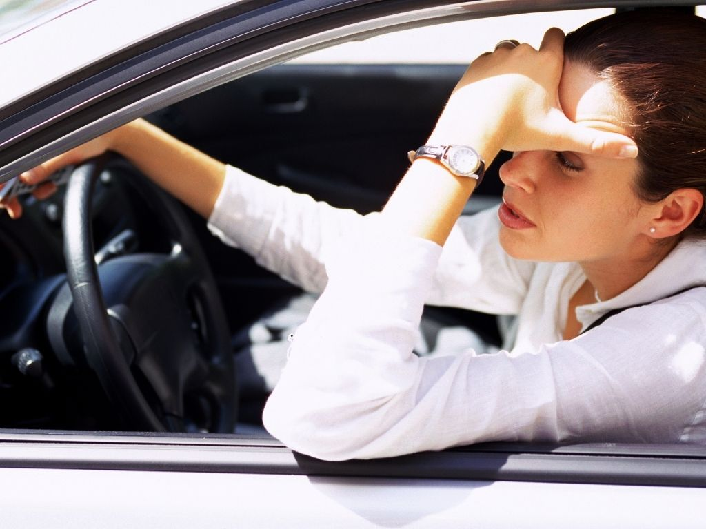 female driver stuck in traffic