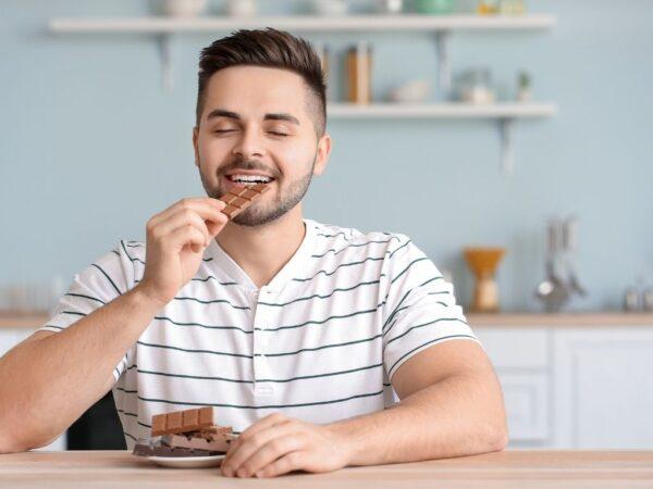 Man snacking on sugary food